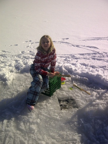 Catching more fish than her brothers at her Georgian Bay Winter Cottage Vacation